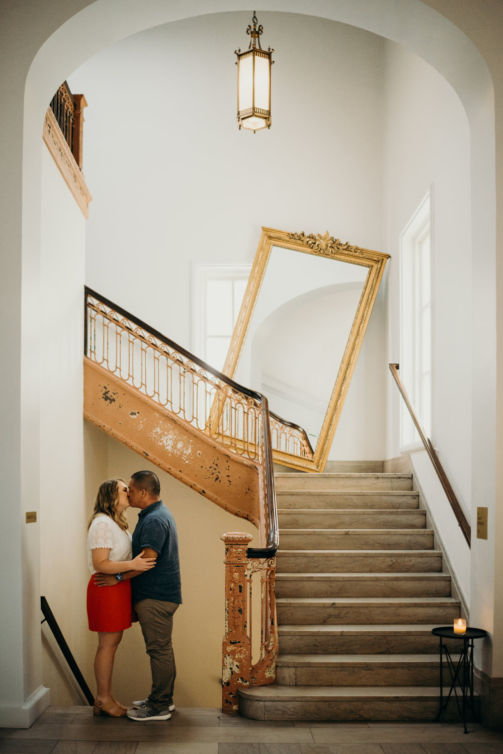 engaged couple kissing in the lobby of the LINE hotel in Washington DC