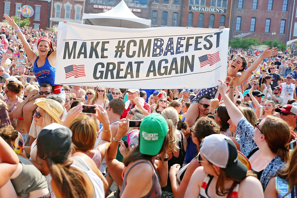 Fans hold up sign at Riverfront stage during CMA Fest