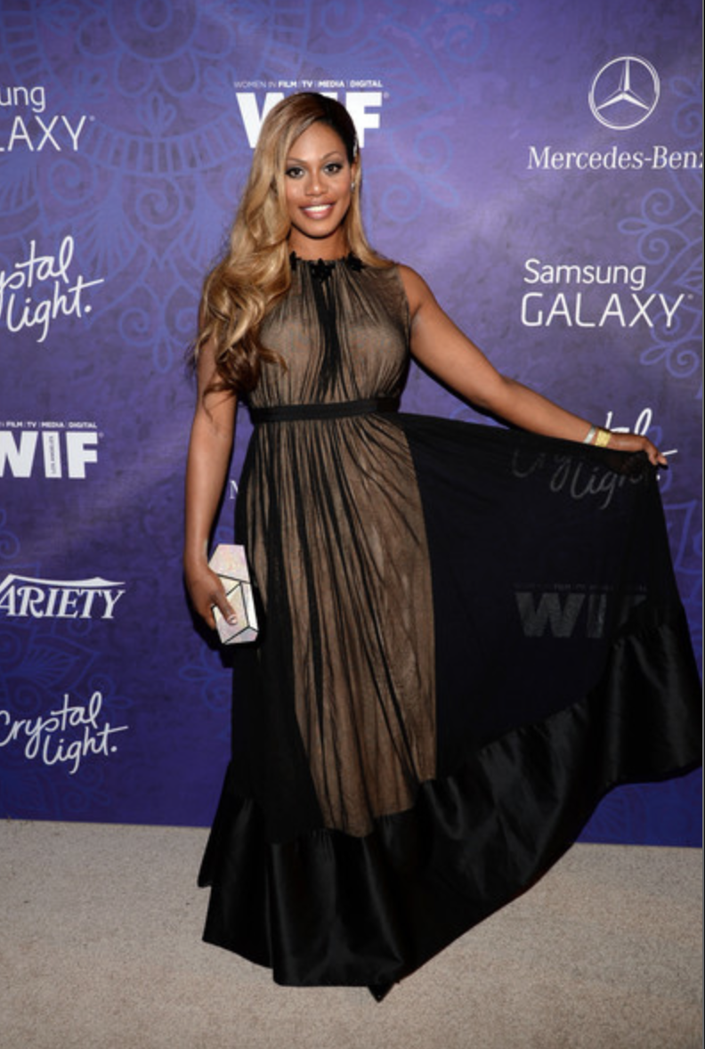Laverne Cox at the Variety 2014 Pre-Emmys Party. Wearing Ports 1961 gown, Rafe clutch, David Yurman stacked bracelets, Neil Lane hairpiece and Lynn Ban earrings and rings.