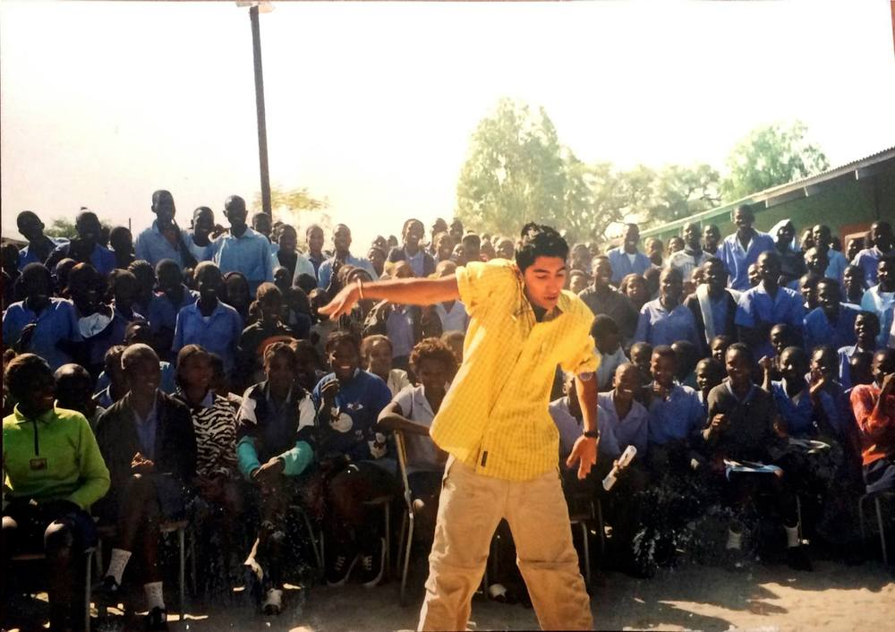 """Ankit Love dancing for the school children in Shituwa, Namibia where parts of the documentary """"Learning Peace"""" were filmed.Here he as the President of the Namibia Charity Group from Cobham, Surrey helped to build and develop a school in the rural backwaters of Namibia, Africa."""