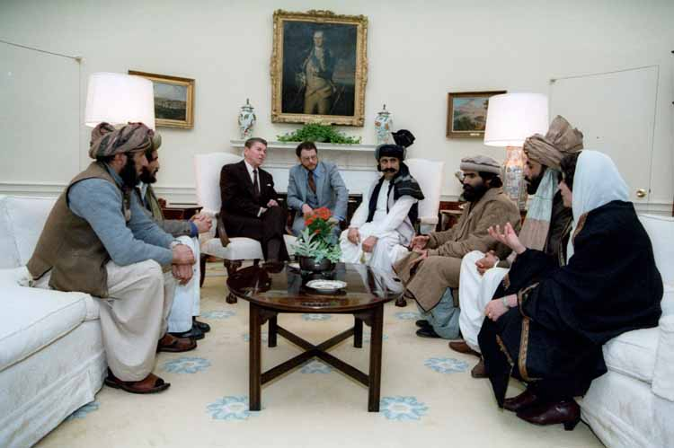 President Ronald Reagan and CIA chief Mr. Avrakotos with their allies the Afghan-Pakistan Mujahideen Islamic terrorist leaders, that they were then funding through Operation Cyclone. White House, Washington DC, 1983.