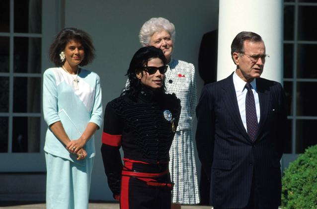 "President George Bush Sr., former head of the CIA, honours Michale Jackson, the Prince of Pop, as the ""artist of the decade"" as the secret CIA operation Cyclone funding the  Afghan-Pakistan Mujahideen  reaches it's climax. At over $20 billion dollars it is believed to be the longest and most expensive CIA operations in history. White House, Washington D.C., 1990."