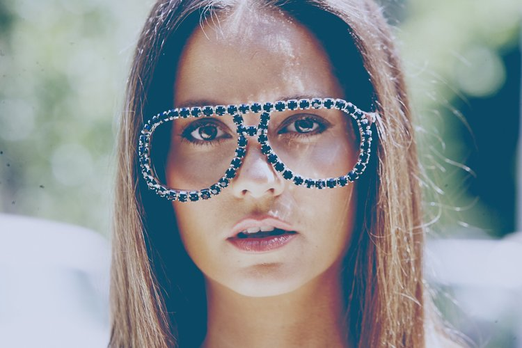 Nadine Vinzens models blinged up Kasluv glasses.