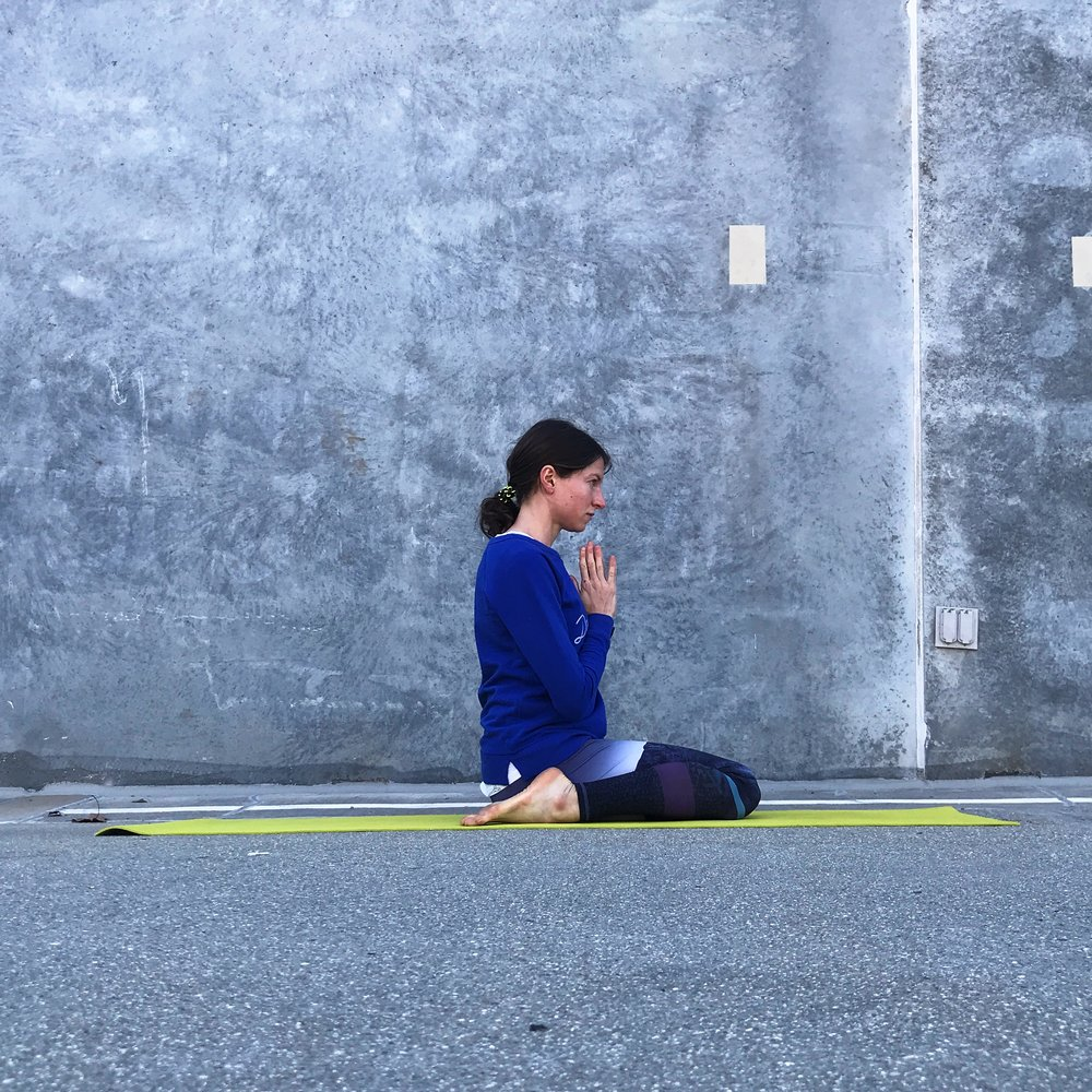 "In virasana (aka ""hero's pose""), be sure to keep knees together. Roll calves outward using your hands before sitting right between your heels. Use a folded blanket or block if sitting directly on the floor is too intense."
