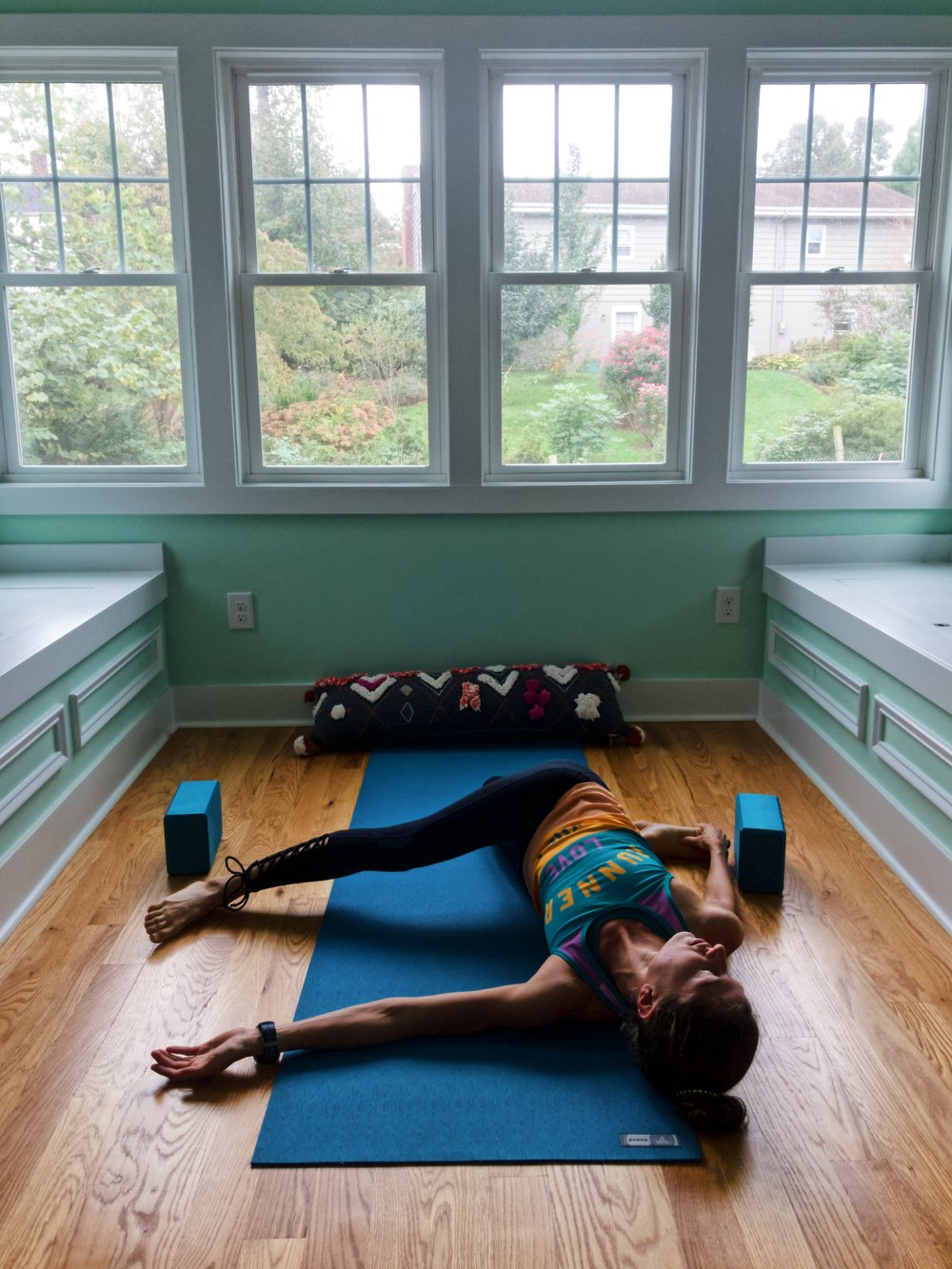 """Cat pulling tail""  is an effective hip and IT band stretch for your top leg, but also a great quad stretch for your bottom leg—and all you have to do is just lie here and relax!"