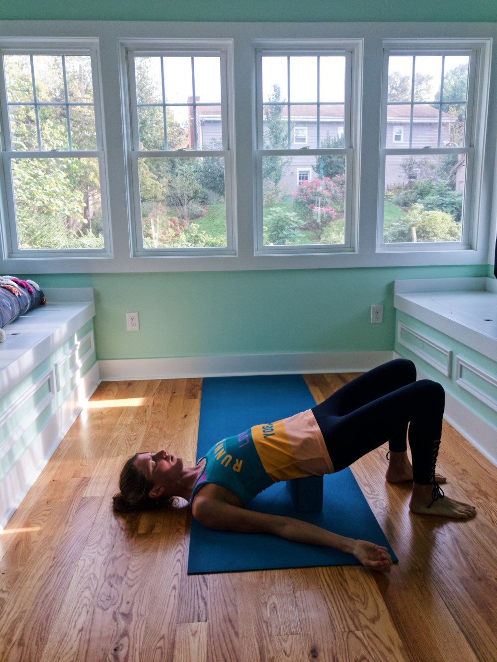 In  supported bridge pose , really just allow yourself to relax down into your block.
