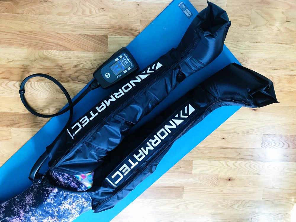 Taking NormaTec to the yoga mat makes for one heck of a restorative savasana.