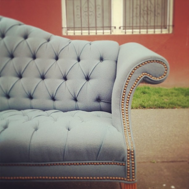 vintage tufted camelback sofa