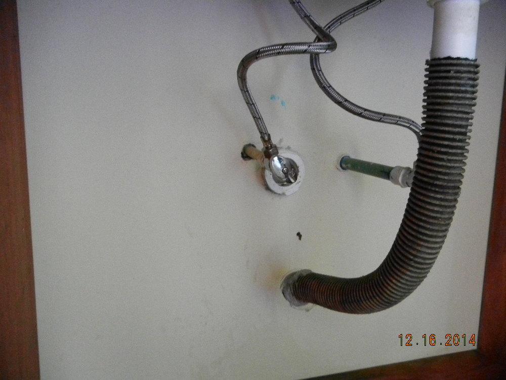 sink hose hanging.JPG