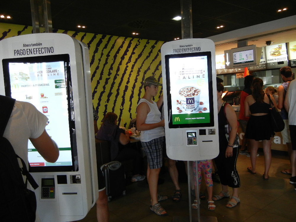McDonalds with large, electronic ordering screens