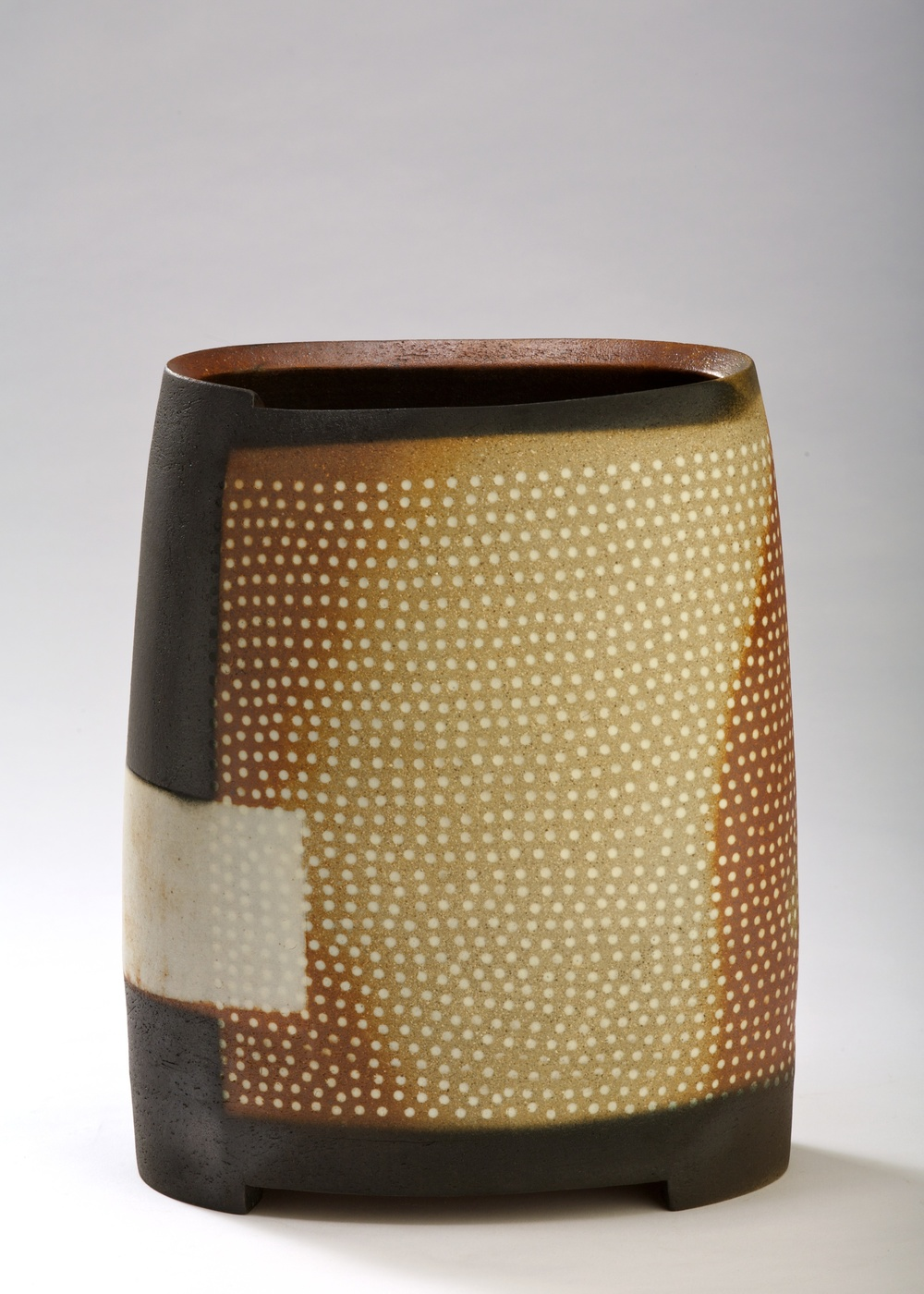 Thrown altered and cut form.  embossed pattern with Inlaid slip.  Stoneware  350mm H  2009