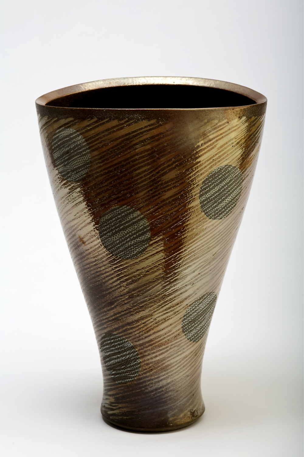 thrown and altered stoneware form.  incised pattern with inlaid slip.  Fired in charcoal with Mt Gibraltar granite lustre  420mm H