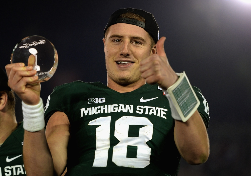 Connor Cook has to be a captain without having the official title.