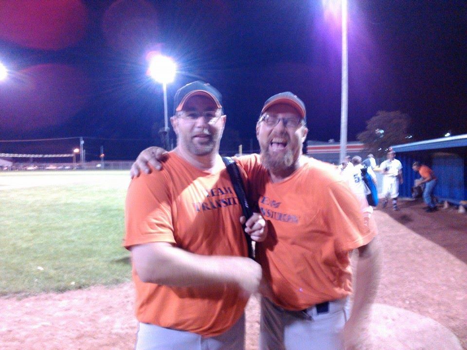 Greg Rinke and Danny Arnold share a moment after Transition's 12-8 victory over Palacios.