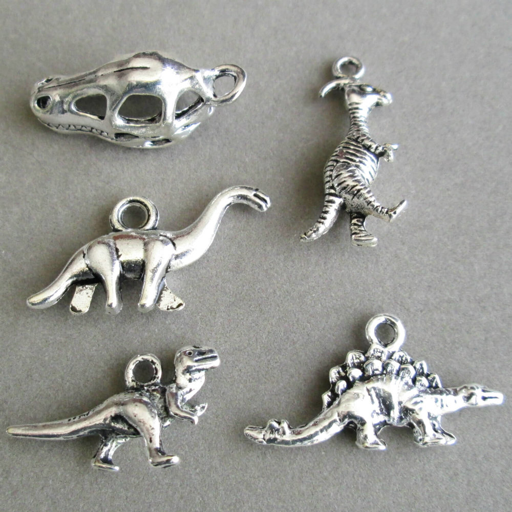Click the photo for dinosaur charms that can be added to any pendant necklace or key chain!