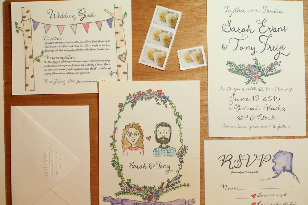 Hand-painted watercolor wedding invitation suites.