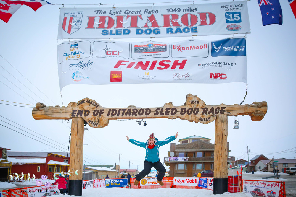I didn't get to see any mushers finish, but the Burled Arch is enough for now. Bethany is the queen of jumping photos and proves it at the Iditarod Finish Line.