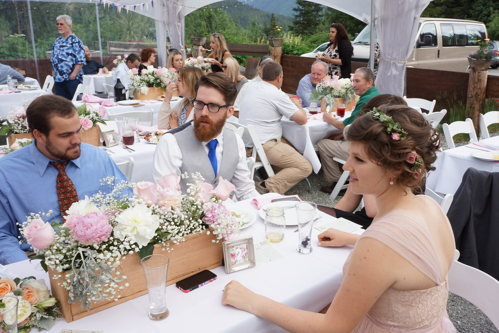 Take a moment to appreciate all your hard work! The centerpieces, home-sewn napkins and bunting, the scavenger hunt at the table... all of it made our day amazing and fun! Photo: Brandon Hafer