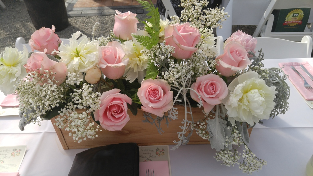 Close up on our centerpieces: wooden boxes made by Tony, flowers from Fifty Flowers, arrangement by Susan Galagaran.