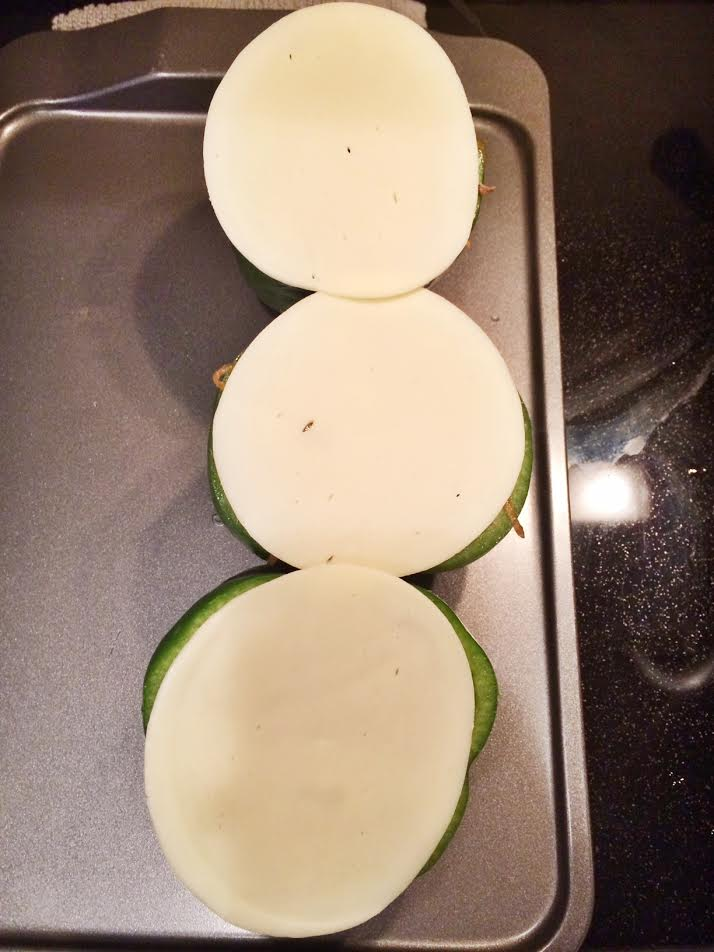 Finish the bell pepper off with a slice of provolone cheese.
