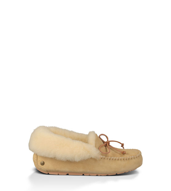 """A classic slipper with a rubber sole, and one of Oprah's Favorite Things! I love UGG! I currently wear my tall UGG boots as my """"slippers"""", they're my favorite and I've worn the fuzzy lining down."""