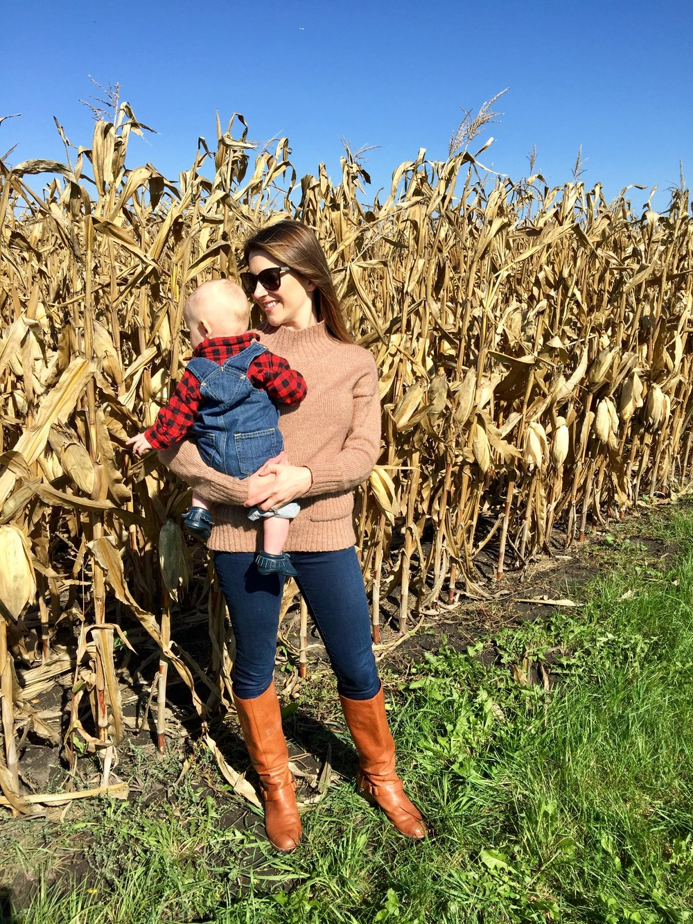 G didn't know what to think of the corn.  Outfit details, sweater is from Nordstrom's, but sold out, HOWEVER, I found it on super sale here.  Jeans are my favorite high rise jeans.  Boots are SOOOO old by Coach(my favorite whiskey color boot), similar here