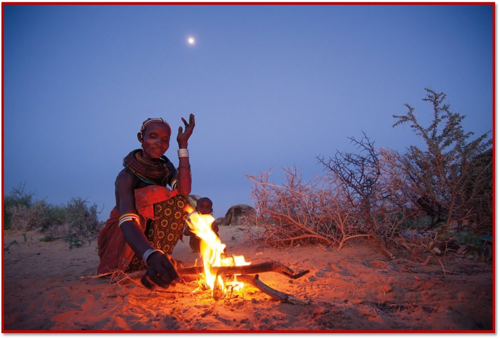 african woman tending fire.jpg