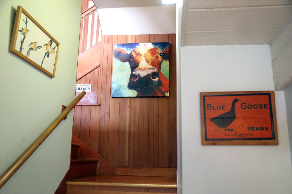 Paintings on the walls along the stairway