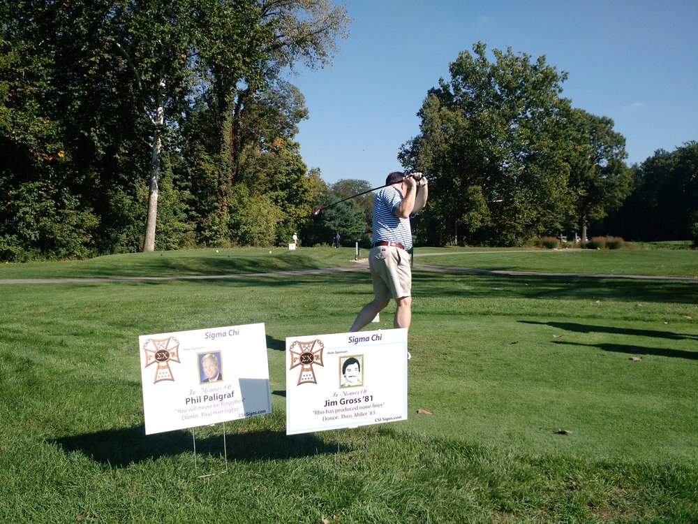 Thad Ailes tees off on a hole sponsored in memory of some members of the Chapter Eternal