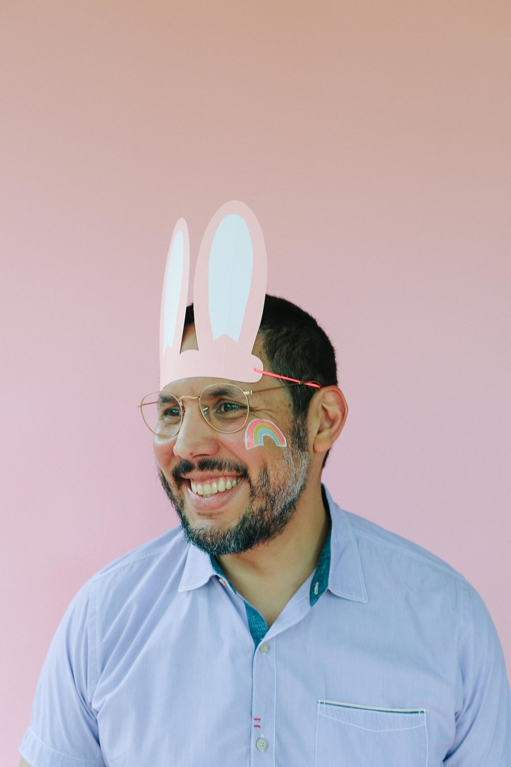My husband is such a good sport, I absolutely love this portrait of him, rainbow tattoo and bunny ears. LOVE!