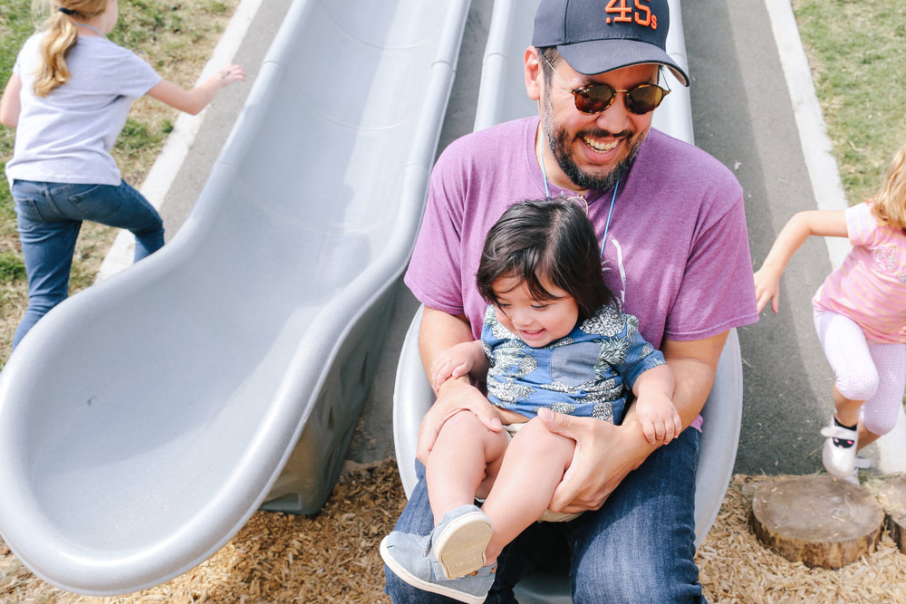 He loves going down the slide with his Dad.