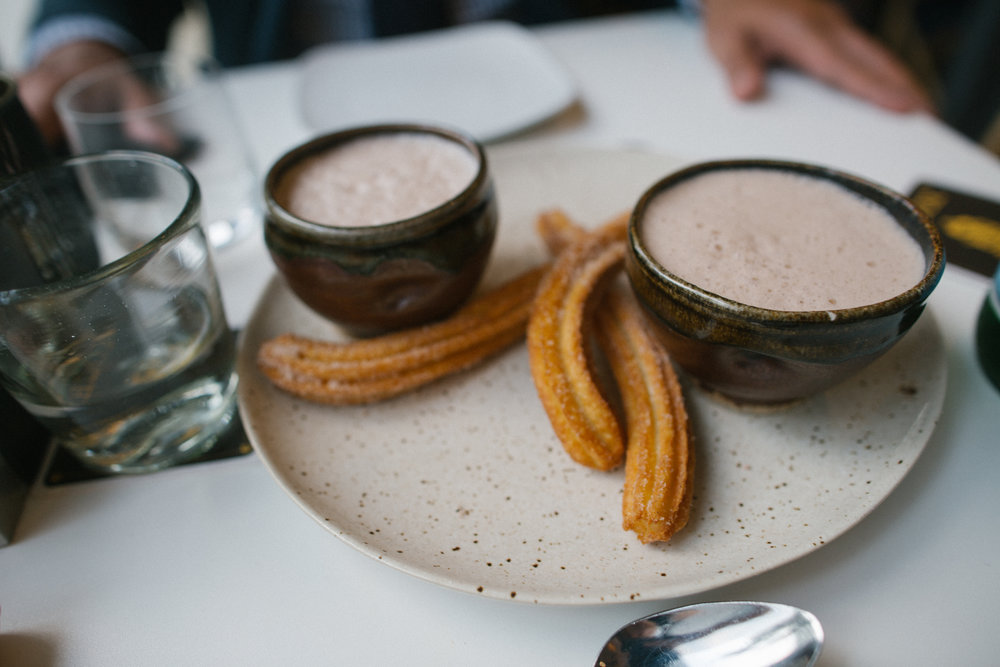 Chocolate Caliente-  Small pitcher of Oaxacan hot chocolate, foamed tableside, and churros.