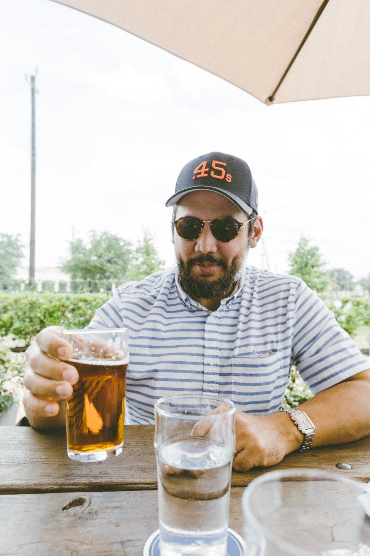 Enjoying a beer at Karbach Brewery.
