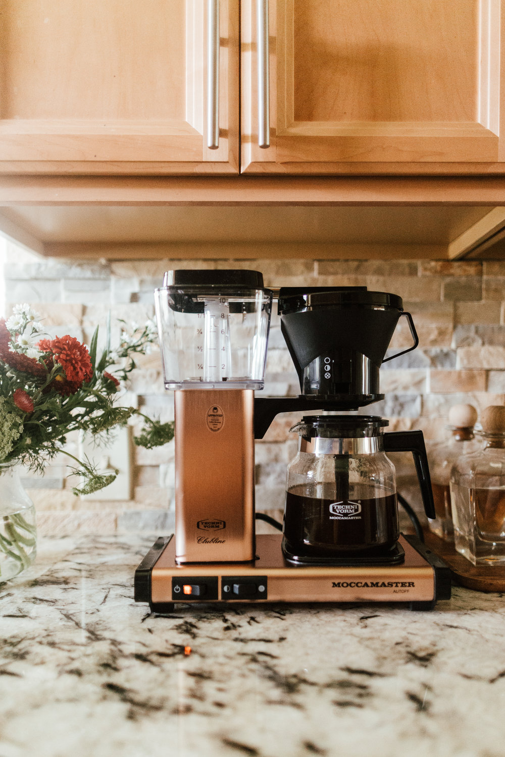 We got a new coffee maker, and boy it's a beauty. Nicholas and I both drink our coffee black. I occasionally add a little almond milk, so we really didn't need any bells or whistles. That didn't stop me, however, from getting a rose-gold colored coffee maker. :) It's SO PRETTY!