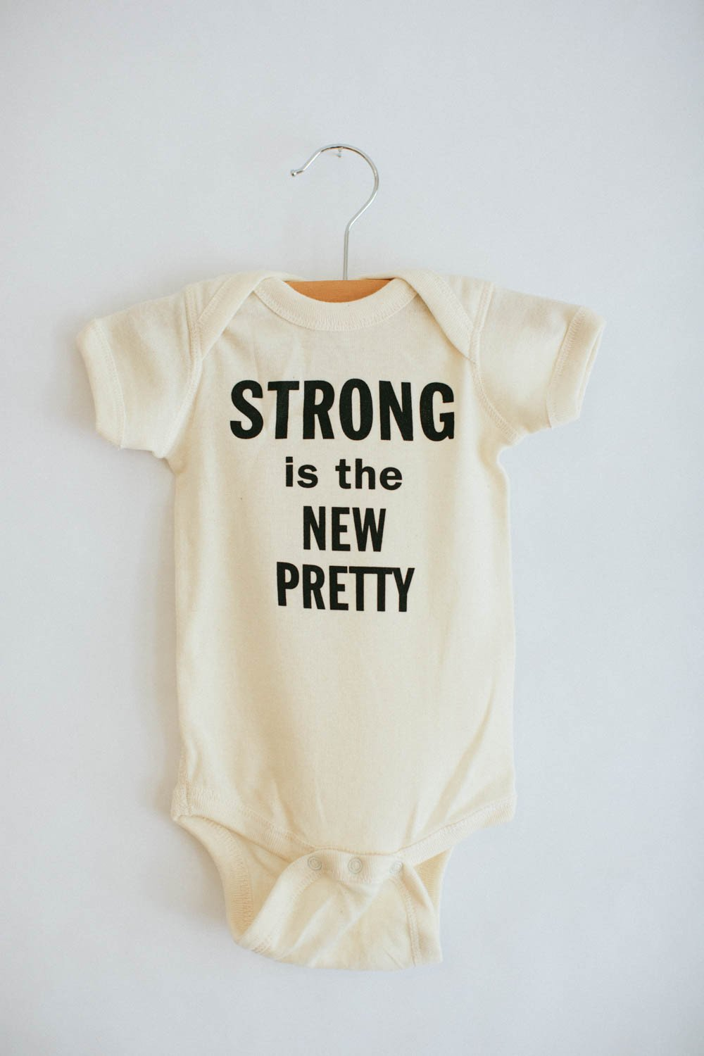 strong_is_the_new_pretty___onesie___the_bee_the_fox-1_1050x@2x.progressive.jpg