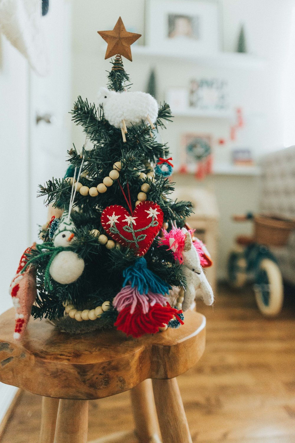 The kids have their own Christmas. All of the ornaments are made out of wool.