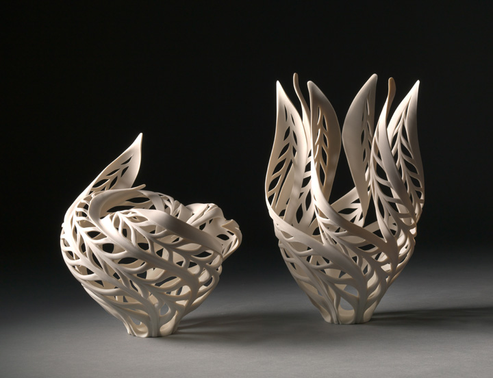"""(Left) Jennifer McCurdy, """"Butterfly Wind Candle Vase,"""" 7x7x7 in, $900 (Right) Jennifer McCurdy, """"Butterfly Magritte's Candle Vase,"""" 9x6x6 in, $900"""