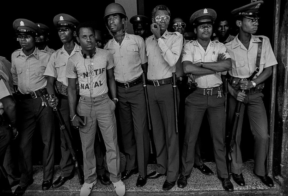 Port-au-Prince, Haiti 1987: Police wait to react to a demo