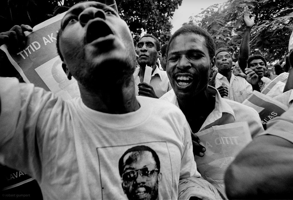 "Port-au-Prince, Haiti 1990: Supporters of Jean-Bertrand ""Titid"" Aristide wait for his return"