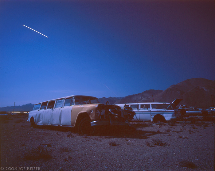 Stretch taxi cabs, Mojave Desert salvage yard -- by Joe Reifer