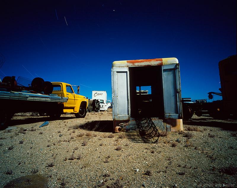 Various trucks, cans, detritus -- by Joe Reifer