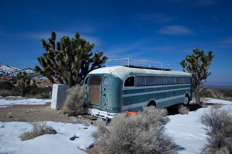 Abandoned school bus in the snow, Mojave Desert -- by Joe Reifer