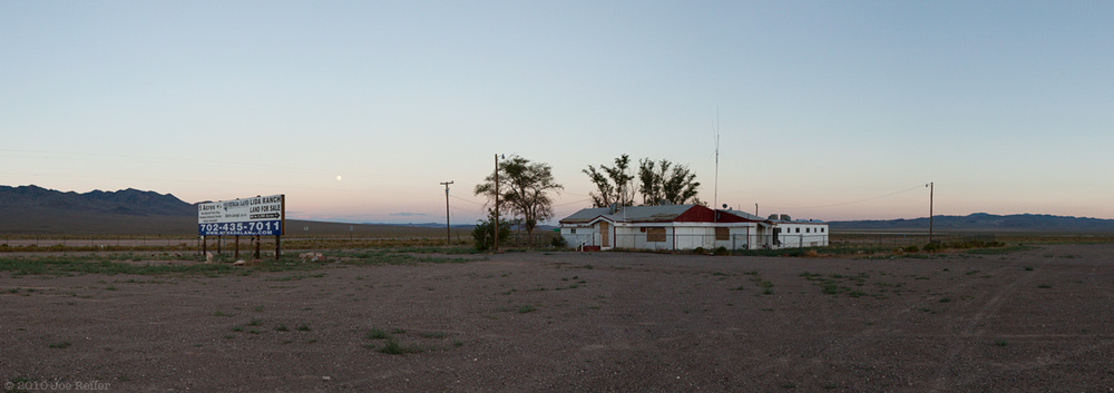 Sunset and moonrise over abandoned Nevada brothel -- by Joe Reifer