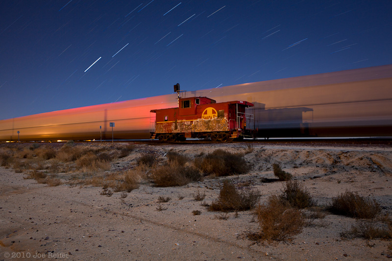 Santa Fe Caboose on the Night Plain I - by Joe Reifer