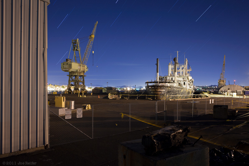 Night photo of the SS Solon Turman in dry dock for dismantling at Mare Island -- by Joe Reifer