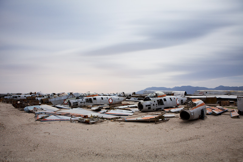 Clouds over desert airplane boneyard -- by Joe Reifer