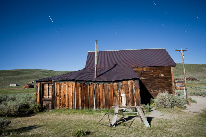 Bodie house with bicycle and sawhorse -- by Joe Reifer