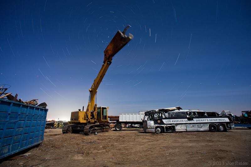 Dinosaur and crashed Sheriff's bus, Paul's Junkyard -- by Joe Reifer