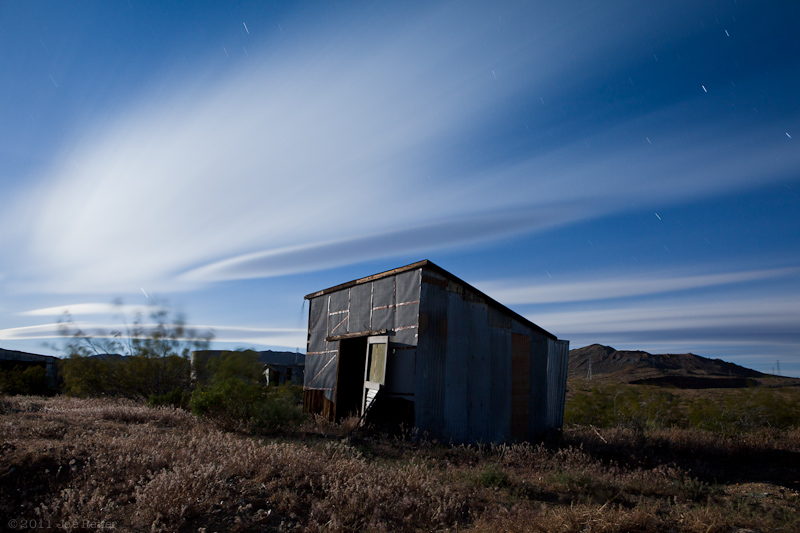 Miner's shack with lenticular clouds, Rand Mining Area -- by Joe Reifer