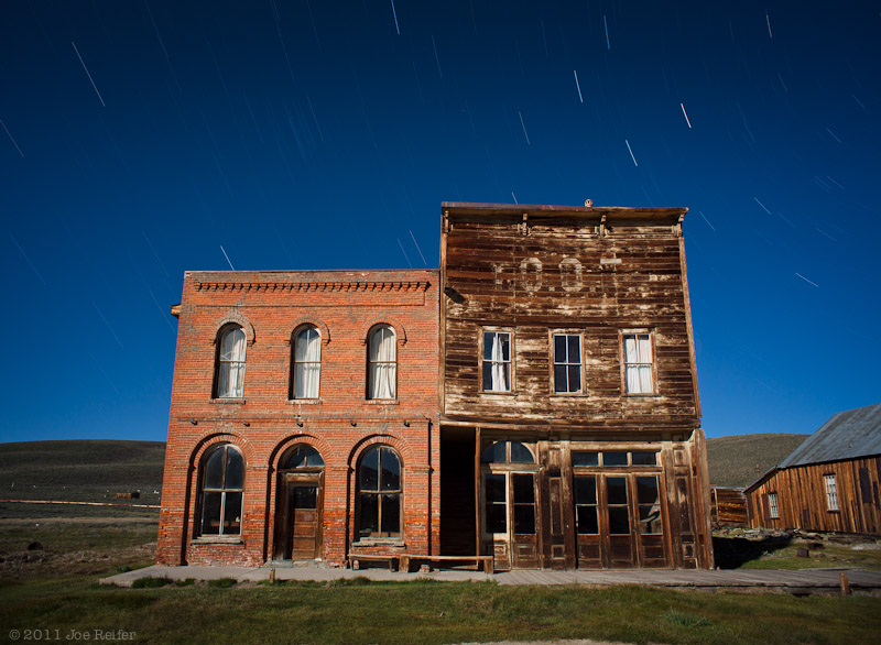 Bodie at night: Dechambeau Hotel and Odd Fellows Lodge (IOOF) -- by Joe Reifer